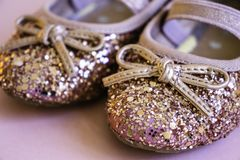 Rose Gold Glitter & Pink Toddler Baby Ballet Pumps. Close up of rose gold glitter & Pink Toddler Baby Ballet Pumps stock photography