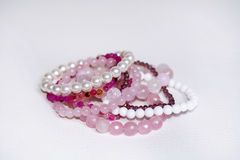 Close up of Rose quartz bracelets Royalty Free Stock Images