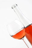 Close-up of rose wine on white background Stock Images