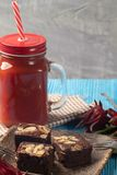 Roselle juice and brownie cake on wooden blue background royalty free stock photos