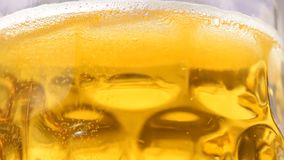Close up of rotating beer with bubbles stock footage