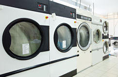 Close-up on rotating drums of washing machines Royalty Free Stock Image