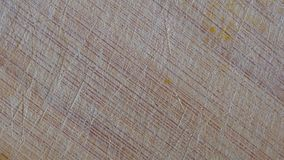 Close-up of A Rotating Used Wooden Cutting Board With Scratches. Background Texture stock video