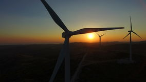 Close up of rotating windmill blades at sunset