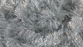 Close-up of the rotation of silver tinsel. Christmas background, tinsel. stock footage