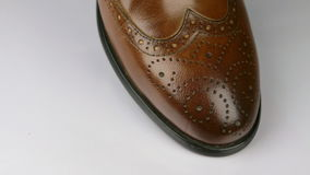 Close-up, rotation of a stylish classic brown shoe with laces. Macro stock video footage