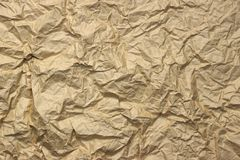 Close-up Of Rough Golden Brown Wrinkled Packaging Paper Texture Royalty Free Stock Photography