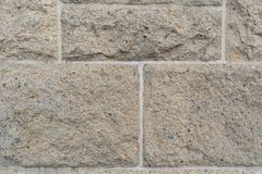 Close up on rough rectangular stone bricks in wall royalty free stock photos