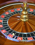 Close up of roulette wheel. With ball on 27 stock photos
