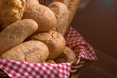 Close up of round bun bread in the basket. On black background Stock Photos