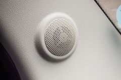 Close up round speaker in modern car. Close up round speaker audio in modern car Royalty Free Stock Photography