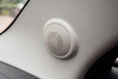 Close up round speaker in modern car. Close up round speaker audio in modern car Royalty Free Stock Image