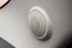 Close up round speaker in modern car. Close up round speaker audio in modern car Stock Photography