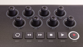 Close-up of a row of knobs on a MIDI  Keyboard Royalty Free Stock Images