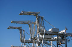 Close up of Row of large shipping crane Royalty Free Stock Photo