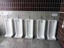 Close up row of outdoor urinals men public toilet.  Royalty Free Stock Image
