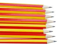 Row of pencil red and yellow alternating isolated on white background. Close up row of pencil red and yellow alternating isolated on white background royalty free stock photos