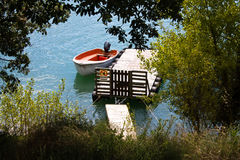 Close up on rowing boat floating on the lake by the shore Stock Photo