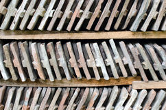 Close up on rows of arranged bricks on a wood shelf. Royalty Free Stock Images