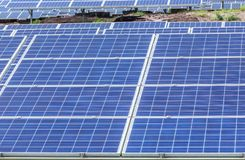 Close up rows array of polycrystalline silicon solar cells or photovoltaic cells in solar power plant station. Turn up skyward absorb the sunlight from the sun royalty free stock photography