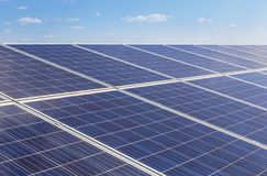 Close up rows array of polycrystalline silicon solar cells or photovoltaics in solar power plant turn up skyward absorb the sunlig. Ht from the sun use light royalty free stock photos