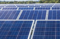Close up rows array of polycrystalline silicon solar cells or photovoltaics in solar power plant turn up skyward absorb the sunlig. Ht from the sun use light stock photography