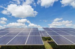 Close up rows array of polycrystalline silicon solar cells or photovoltaics in solar power plant turn up skyward absorb the sunlig royalty free stock photos