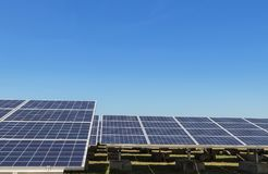 Close up rows array of polycrystalline silicon solar cells or photovoltaics in solar power plant turn up skyward absorb the sunlig. Ht from the sun use light royalty free stock image