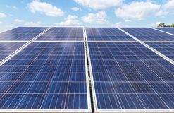 Close up rows array of polycrystalline silicon solar cells or photovoltaics in solar power plant. Turn up skyward absorb the sunlight from the sun use light Stock Image