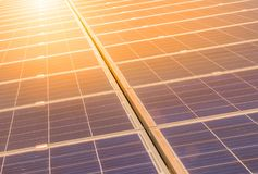 Close up rows array of polycrystalline silicon solar cells or photovoltaics in solar power plant on sunset. Close up rows array of polycrystalline silicon solar Royalty Free Stock Images