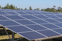Close up rows array of polycrystalline silicon solar cells or photovoltaics in solar power plant. Turn up skyward absorb the sunlight from the sun use light Stock Photography