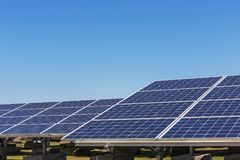 Close up rows array of polycrystalline silicon solar cells or photovoltaics in solar power plant. Turn up skyward absorb the sunlight from the sun use light Royalty Free Stock Photos