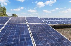 Close up rows array of polycrystalline silicon solar cells or photovoltaics in solar power plant turn up skyward absorb the sunlig. Ht from the sun use light stock photo