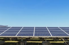 Close up rows array of polycrystalline silicon solar cells or photovoltaics in solar power plant turn up skyward absorb the sunlig. Ht from the sun use light royalty free stock photo