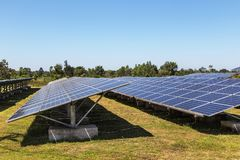 Close up rows array of polycrystalline silicon solar cells or photovoltaics in solar power plant turn up skyward absorb the sunlig. Ht from the sun use light stock images