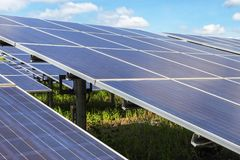 Close up rows array of polycrystalline silicon solar cells or photovoltaics in solar power plant turn up skyward absorb the sunlig. Ht from the sun use light royalty free stock photography
