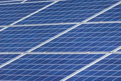Close up rows array of solar cells or photovoltaics. In solar power station alternative clean renewable energy royalty free stock photography