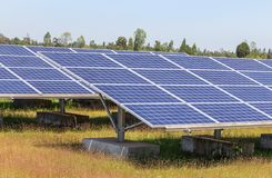 Close up rows array of solar cells or photovoltaics in solar power plant systems stock image