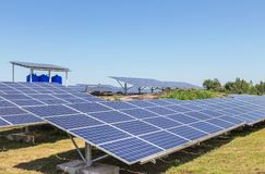 Close up rows array of solar cells or photovoltaics in solar power plant systems royalty free stock photo
