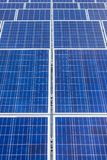 Close up rows array of solar cells or photovoltaics in solar power station. Alternative clean renewable energy stock image
