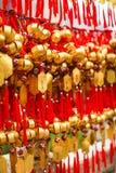 Close up rows Devotees hanging golden prayer bells for blessing at at Wong Tai Sin Temple, Hong Kong.  stock images