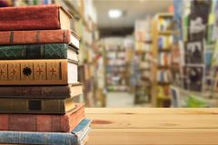Close up of Rows of old books on the table. Table old books rows close up background design Stock Photo