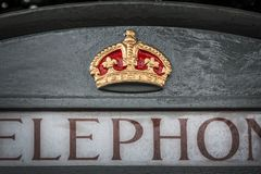 Close up of a royal crown symbol on an english grey phone booth in Bath UK. Close up of a royal crown symbol on an english grey phone booth in Bath, UK royalty free stock image