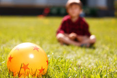 Close up of rubber ball on grass Stock Images