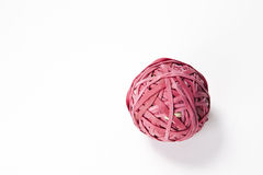 Close-up of rubber band ball over white background Royalty Free Stock Image