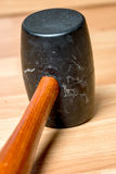 Close up of a rubber mallet with wood handle. Well used black rubber mallet with wood handle Stock Photography