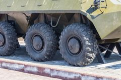 Close up on rubber tires with a large tread to overcome impassable roads and dirt on a Russian made green armored personnel stock photos