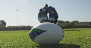 Rugby ball and female rugby players on a rugby pitch stock video