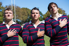 Close up of rugby players looking away Royalty Free Stock Images