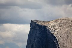 Close up of rugged Half Dome peak with hikers on top Royalty Free Stock Photography